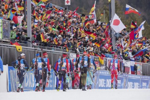 09.01.2016, Ruhpolding, Germany (GER): Event Feature: Athletes walk to the startline infront of the fans with waving flags -  IBU world cup biathlon, pursuit men, Ruhpolding replacing Oberhof (GER). www.nordicfocus.com. © Manzoni/NordicFocus. Every downloaded picture is fee-liable.